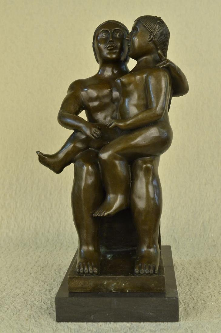 Man and Woman Bronze Statue