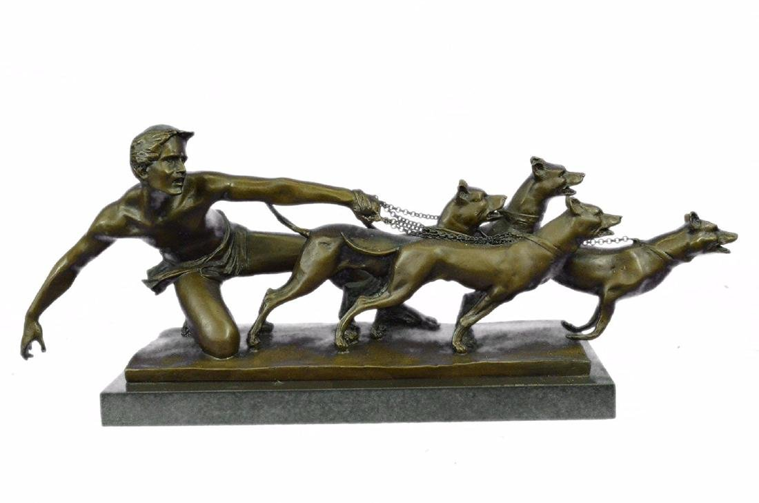 Man Pulling Three Dogs Bronze Sculpture