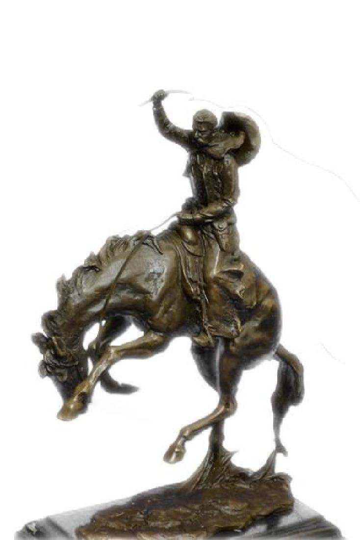 An American Classic Bronco Buster Bronze Sculpture on - 4