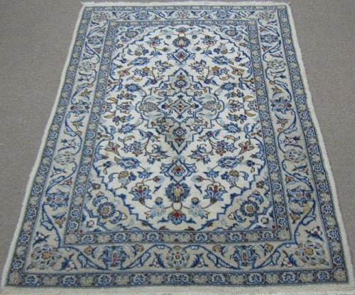Captivating handmade Kashan rug