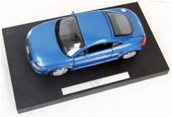 Blue audi tat model car on black base