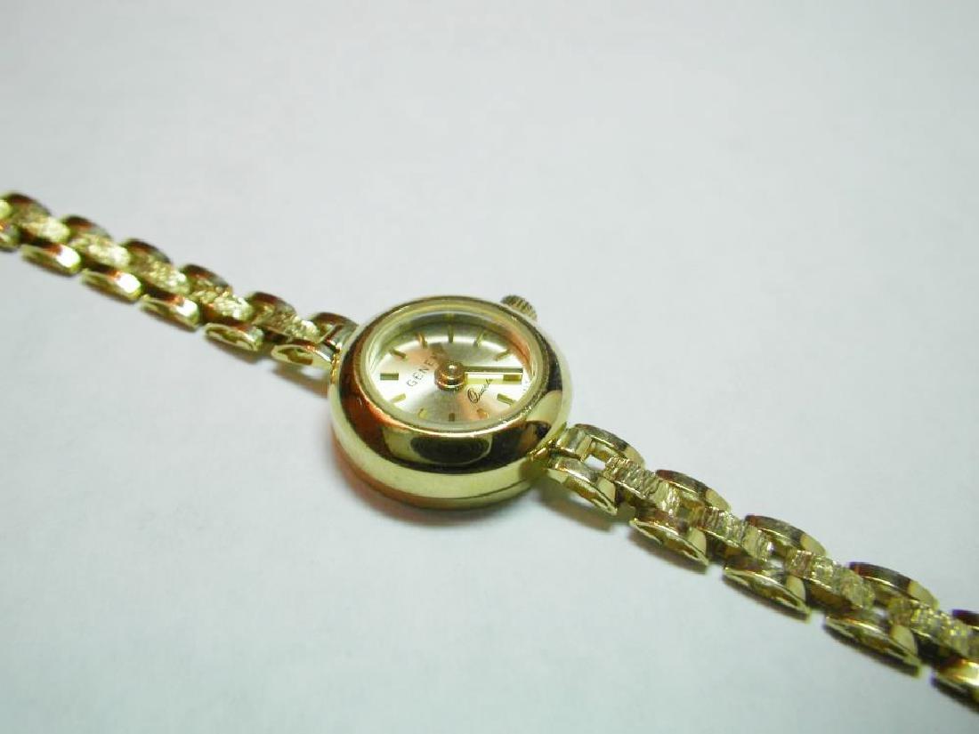 18 Karat Gold Swiss Made Geneva Fancy Watch
