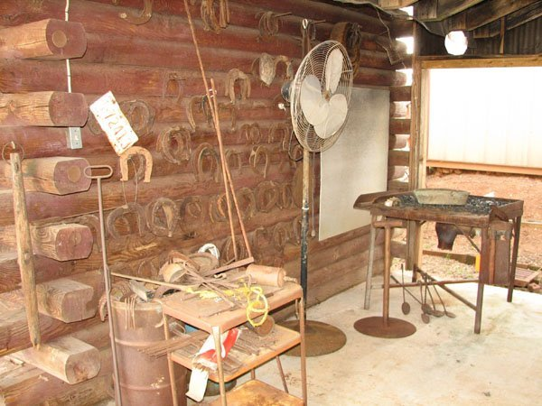 1002: BLACK SMITH TABLE AND LARGE ASSORTMENT OF HORSE S