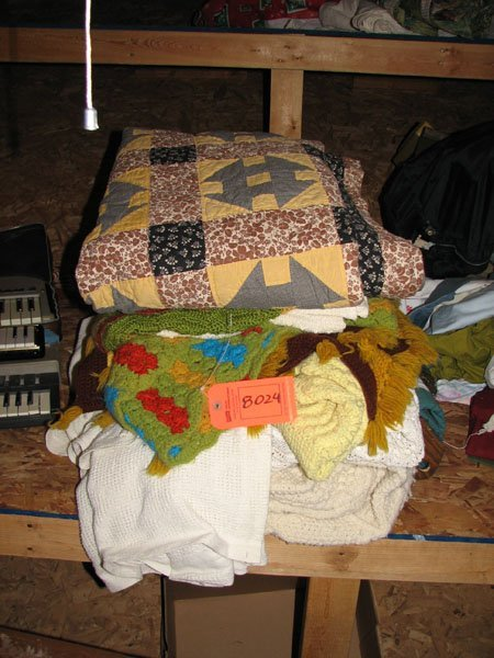 8024: STACK OF QUILTS, 6X6, YELLOW, BLACK, AND BROWN