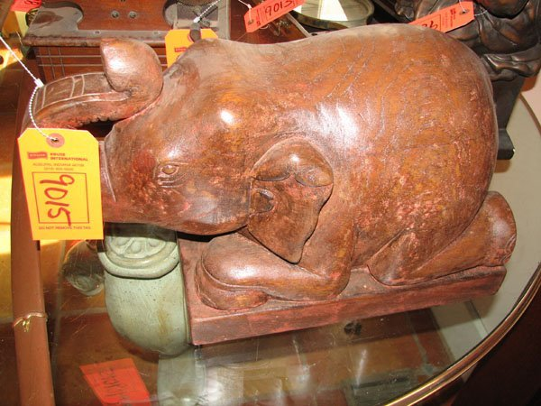 9015: HAND CARVED WOODEN BABY ELEPHANT IN A KNEELING PO