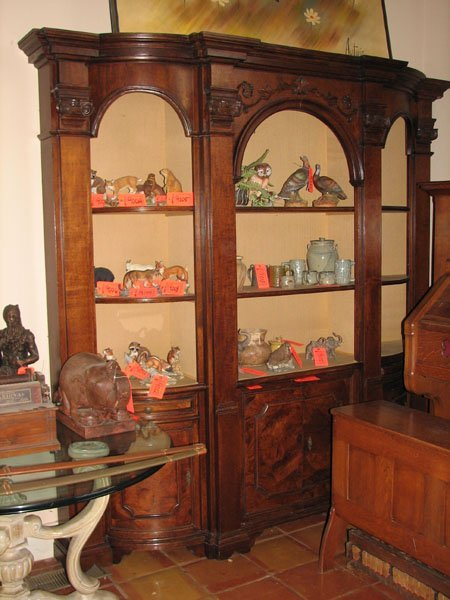 9339: 8' X 8' CURIO CABINET WITH 9 SHELVES, AND 4 STORA