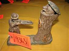 9363: ANTIQUE CAST IRON MECHANICAL COIN BANK WITH A HUN