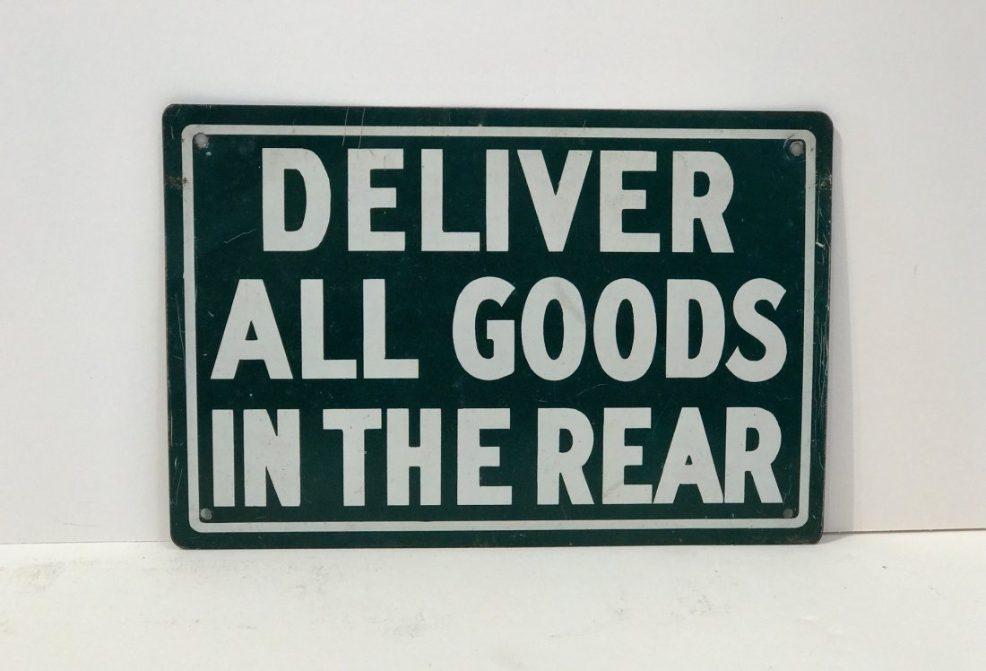"""Deliver All Goods in the Rear"" Sign"