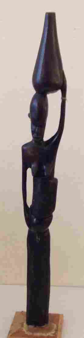 African Tribal Woman Figure in Robust Wood