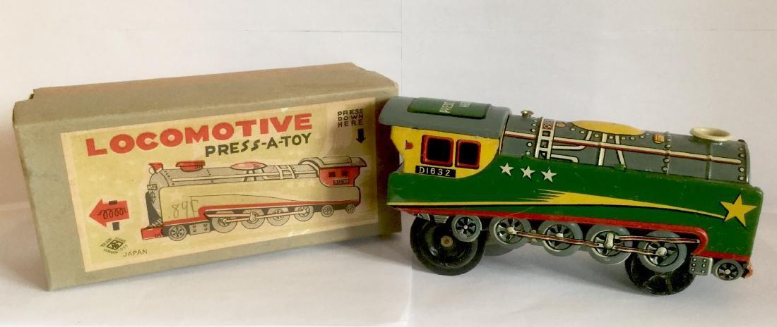 Tin Train - Locomotive Press-a-Toy, 1950's