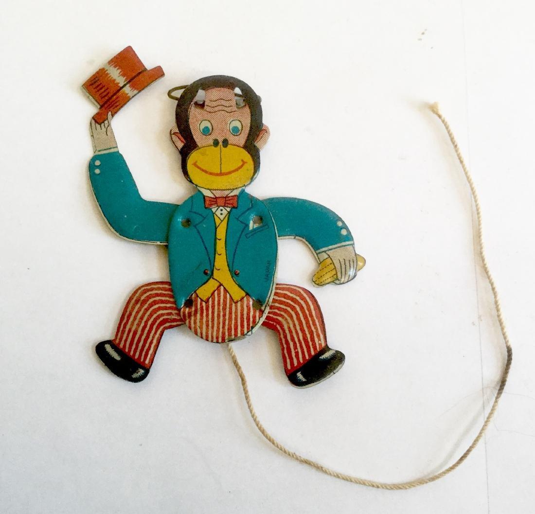 "Tin ""Monkey Tips Hat"" Lapel Pin, 1950's"