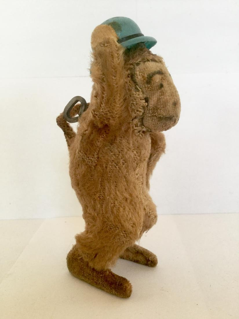 Monkey Tipping Hat Wind Up Toy