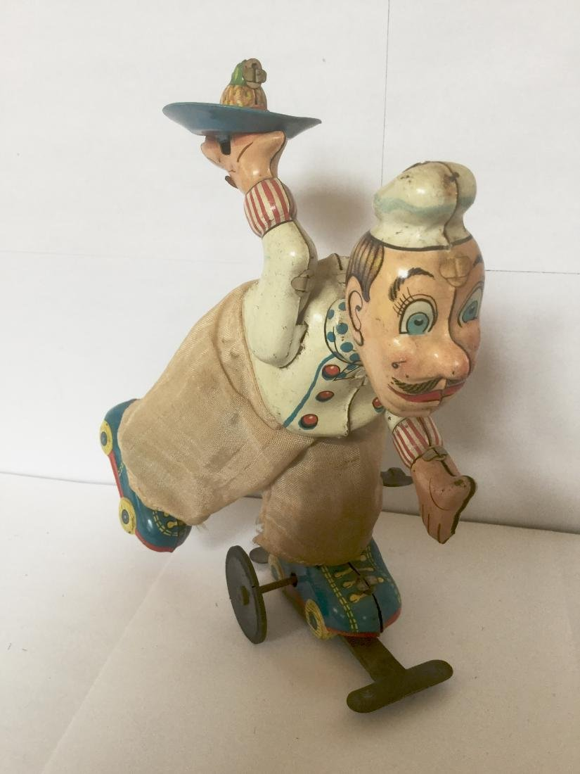 """Tin """"CHEF"""" on Roller Skates Wind Up Toy"""