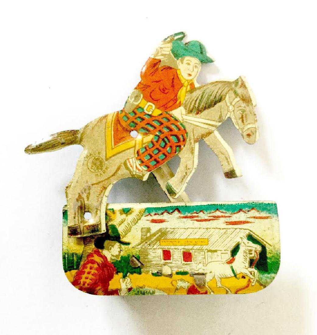 Tin Litho Cowboy Clicker Toy