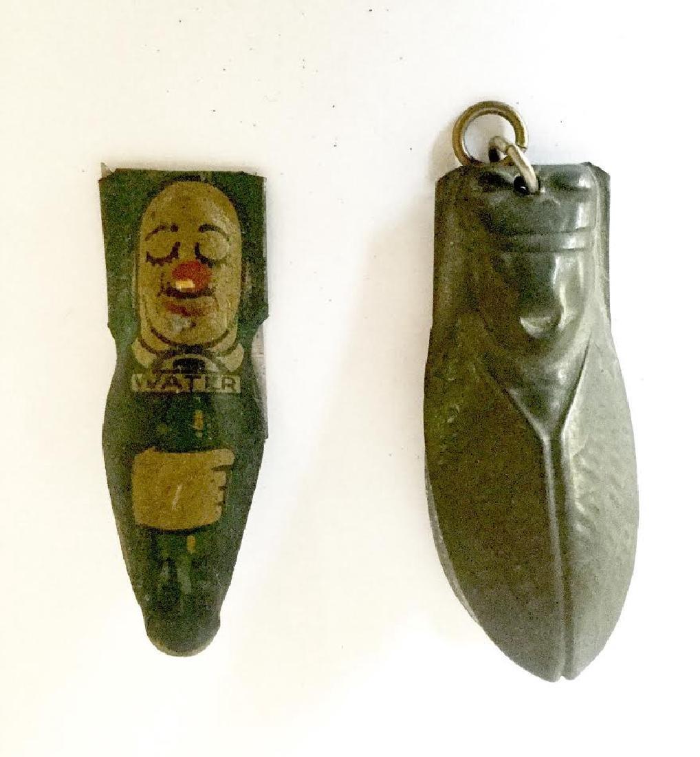 Two Tin Clicker Toys