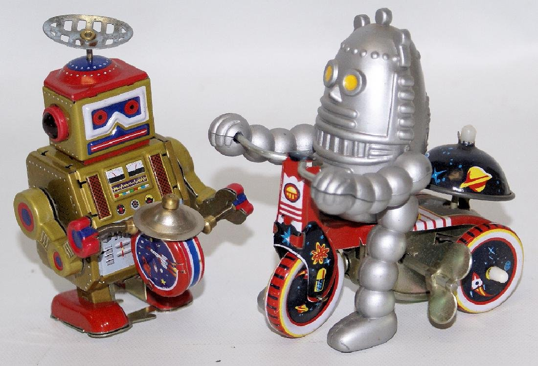 Set of 2 Tin Litho Wind-up Drumming & Bicycling Robots