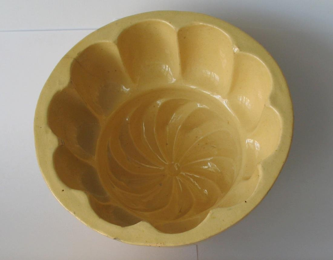 Large Yelloware Scalloped Swirl Mold 1940