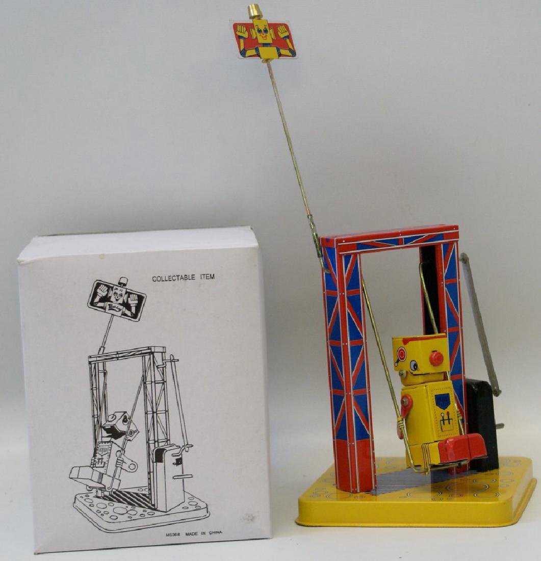 Tin Litho Windup Robot on a Swing MS366 with Key