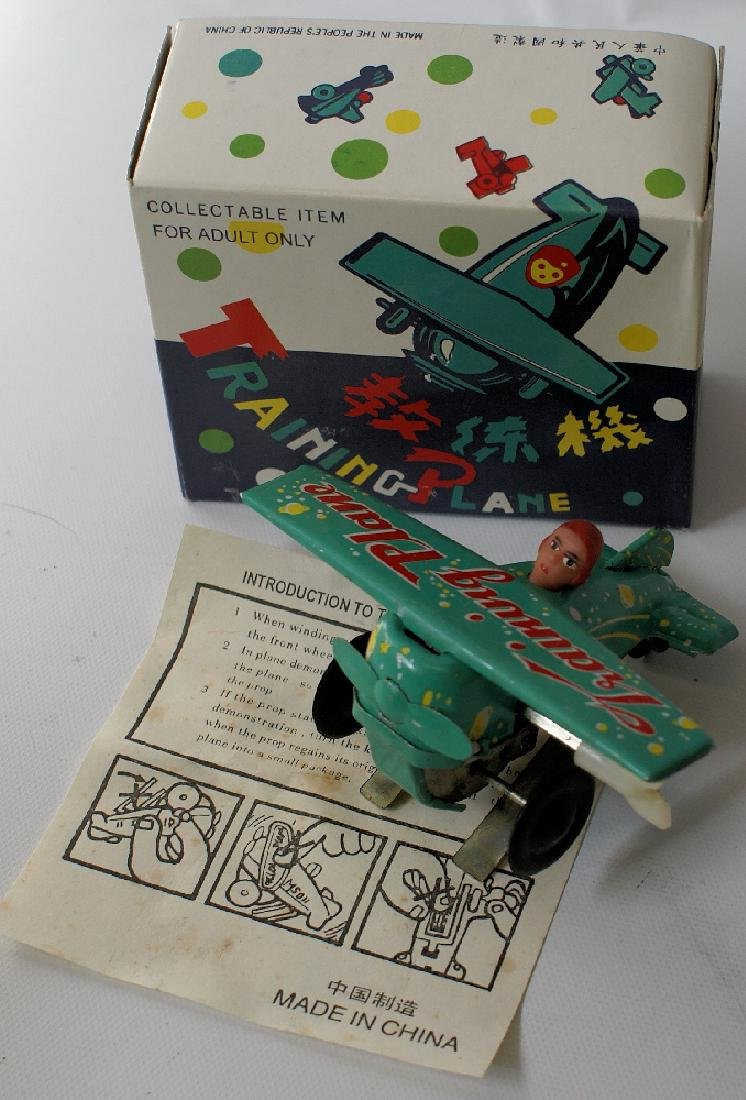 Vintage Tin Green Windup Training Plane Airplane