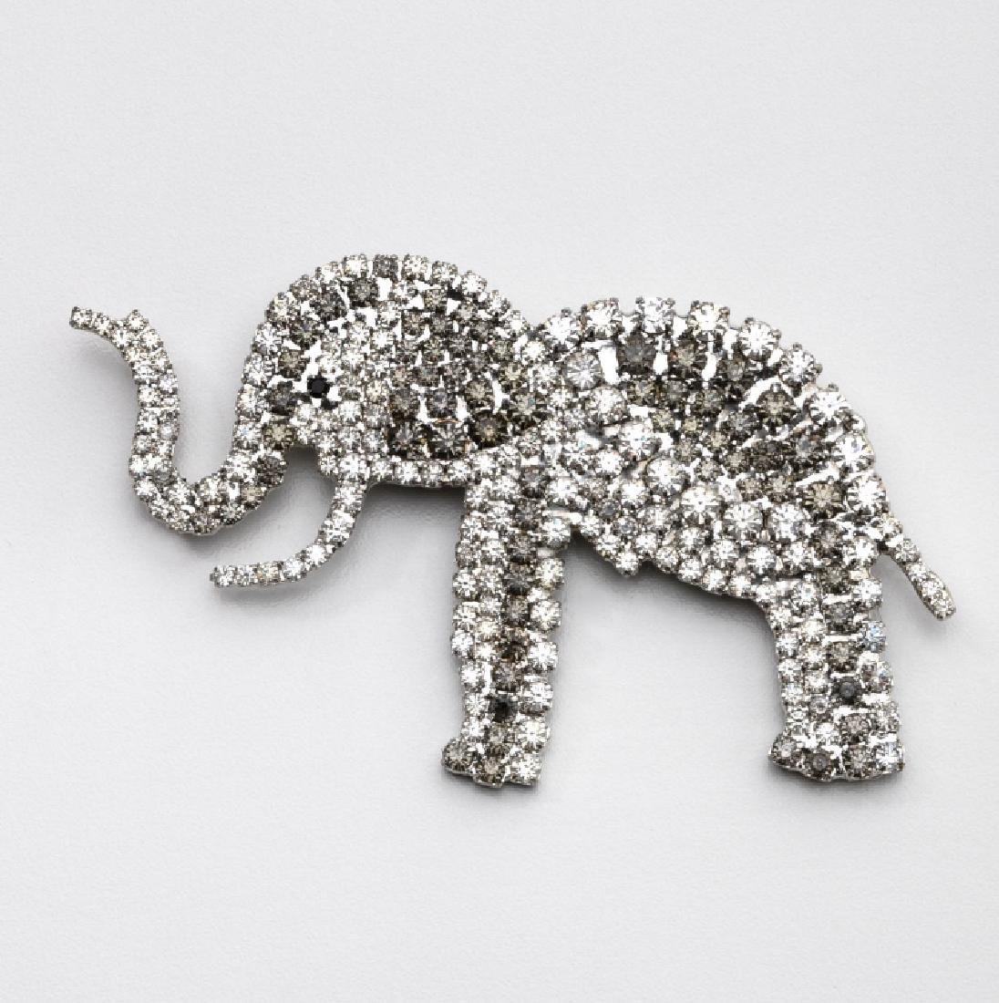 SPARKLING ELEPHANT PROFILE BROOCH, ATTRIBUTED TO BUTLER