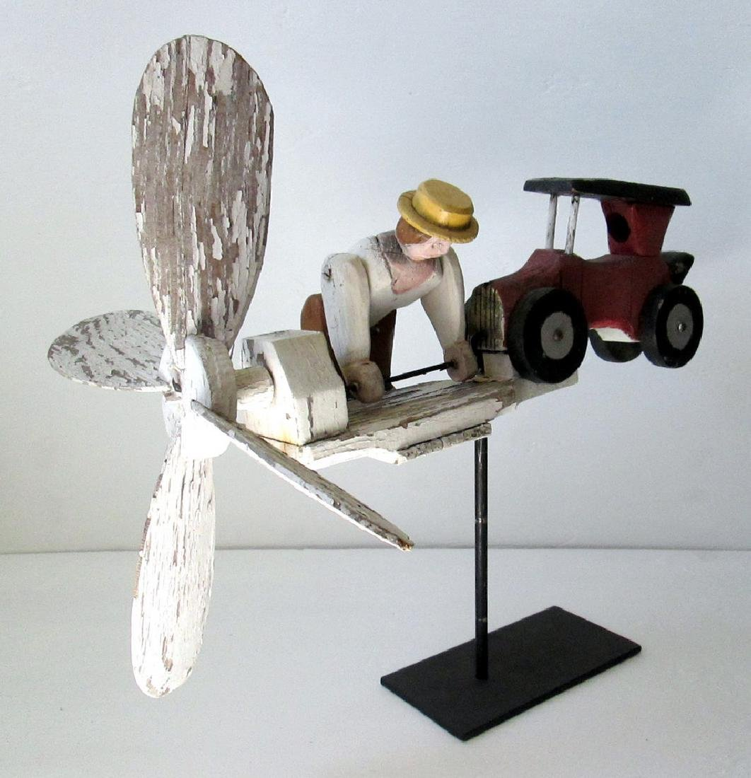 Vintage Man Starting Car Whirligig