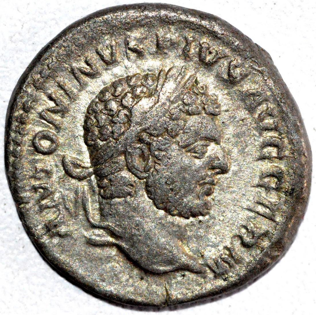 Roman Silver Denarius of Emperor Caracalla - rv. Apollo