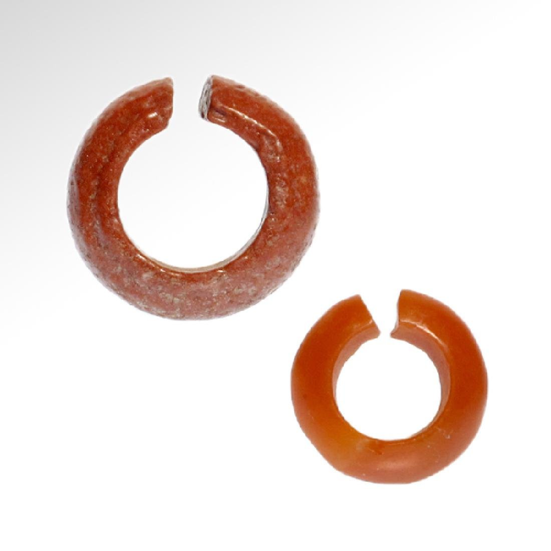 Two Egyptian Red Faience and Cornelian Hair-rings, 18th