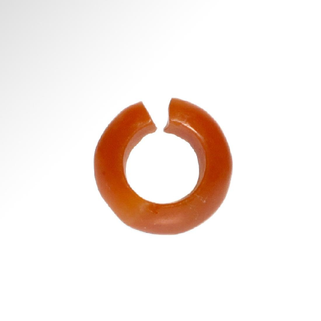 Two Egyptian Red Faience and Cornelian Hair-rings, 18th - 3