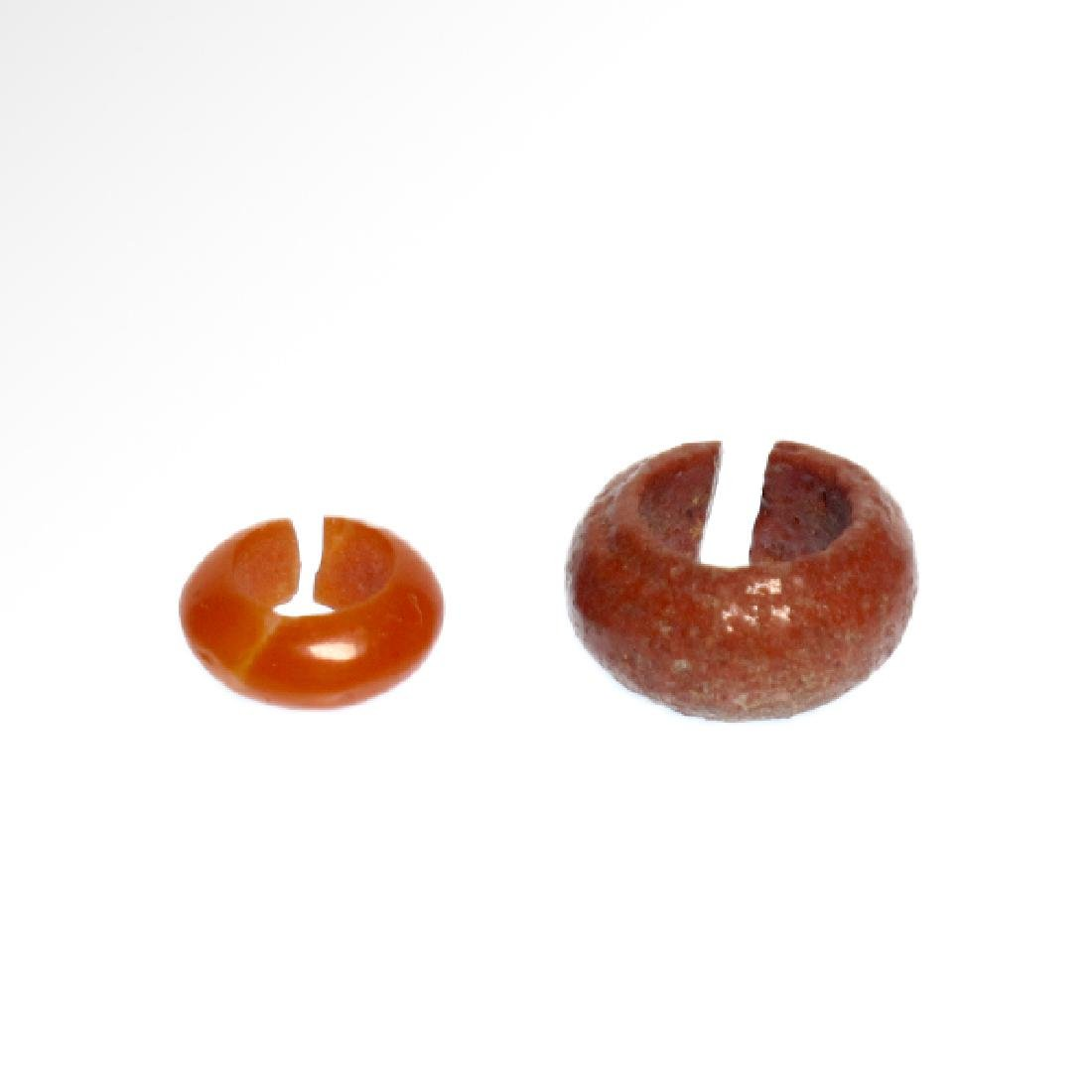 Two Egyptian Red Faience and Cornelian Hair-rings, 18th - 4