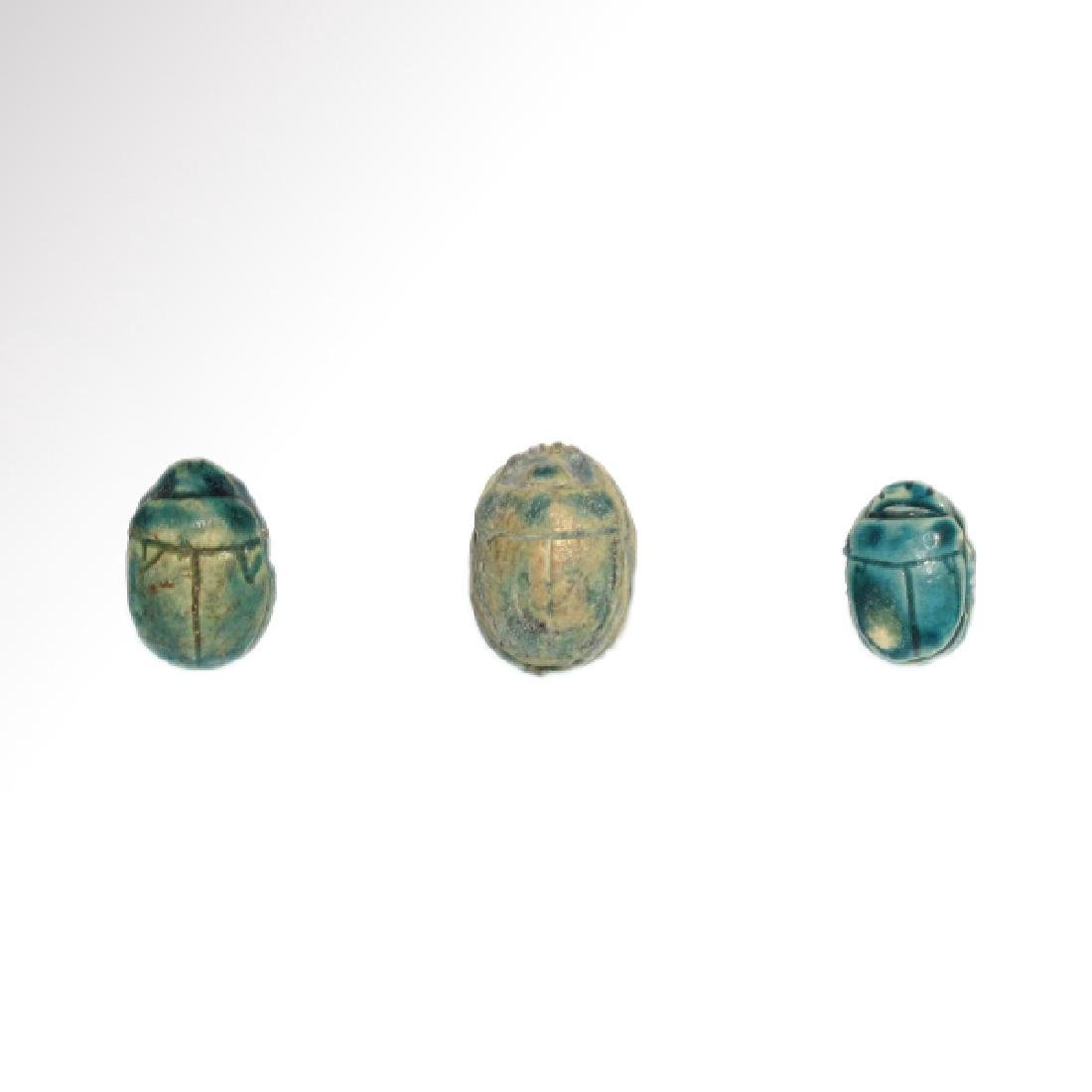 Three Egyptian Glazed Steatite Scarabs, c. 1500 B.C.
