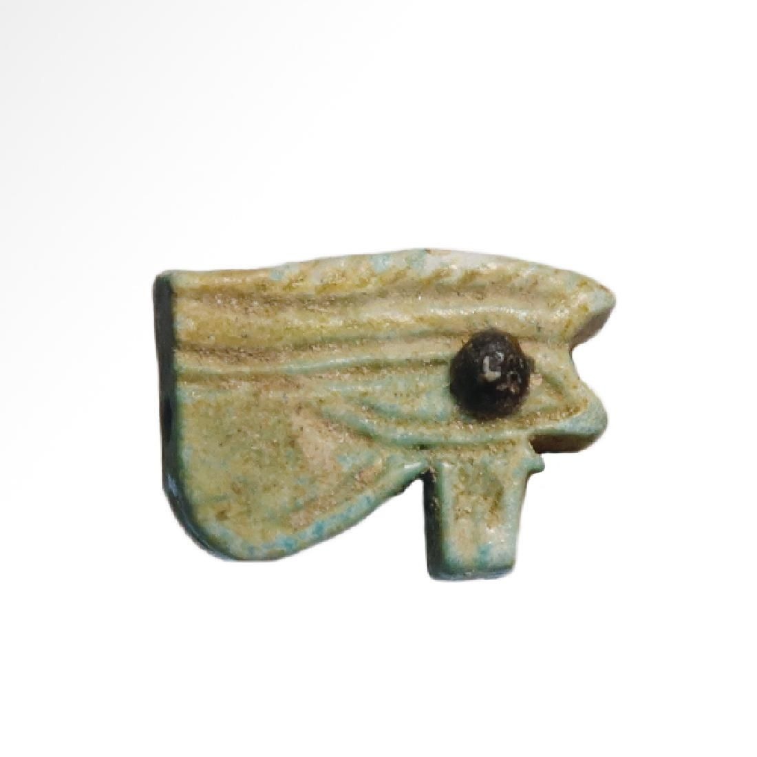 Egyptian Bichrome Blue and Black Faience Eye Amulet,