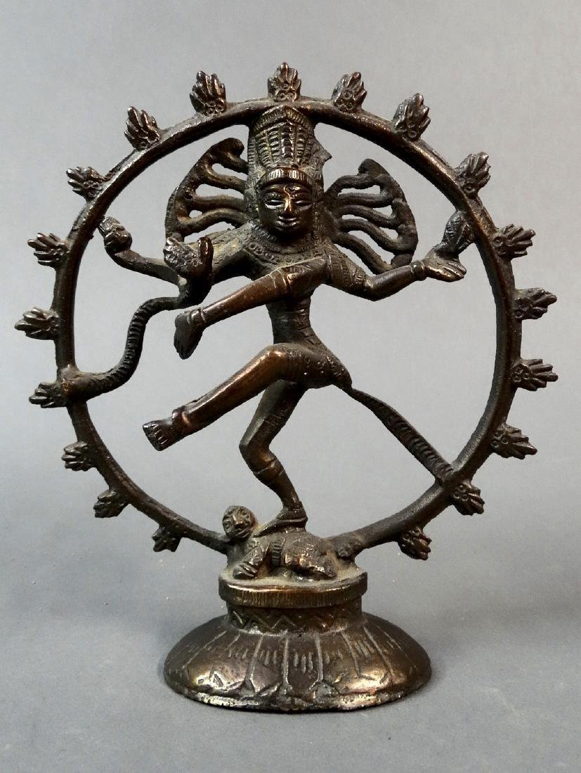 "Four-armed Shiva dances the sacred ""Cosmic Dance"""
