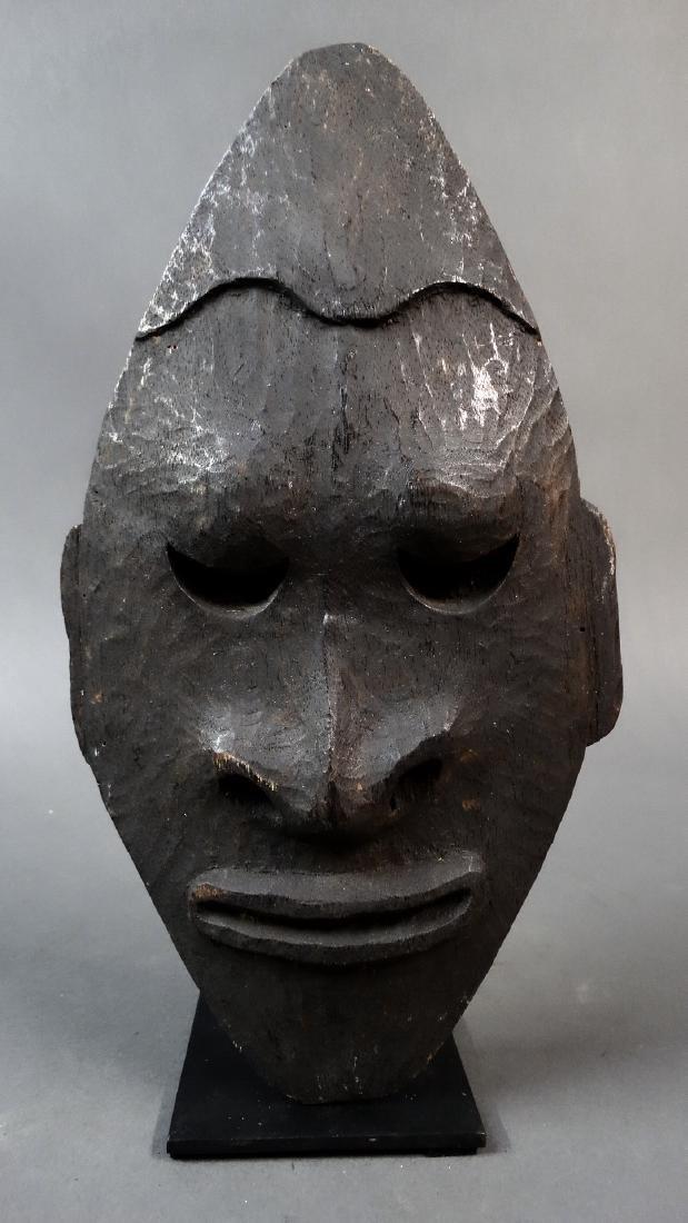 Carved wooden spirit mask
