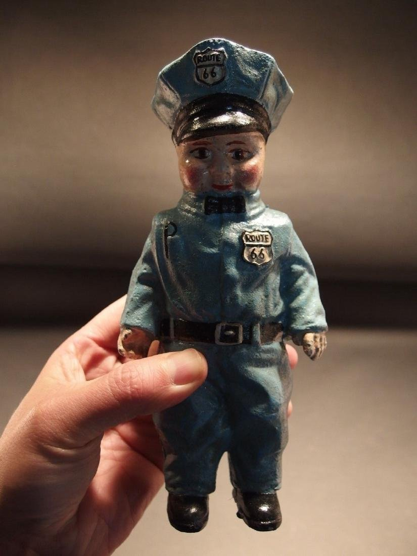 Cast Iron Route 66 Gas Pump Attendant Coin Bank Doll
