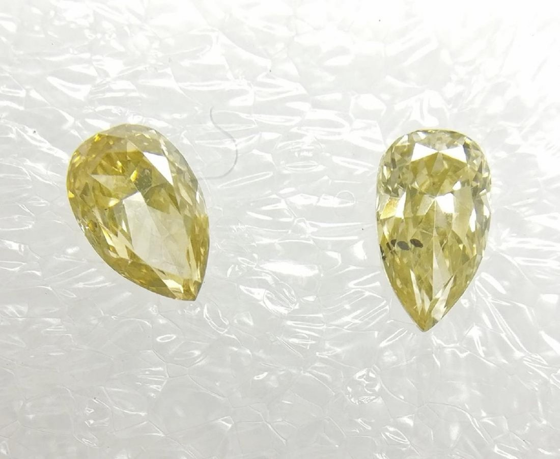 0.33 Carat Lot of 2 Loose Fancy Yellow Pear Diamonds