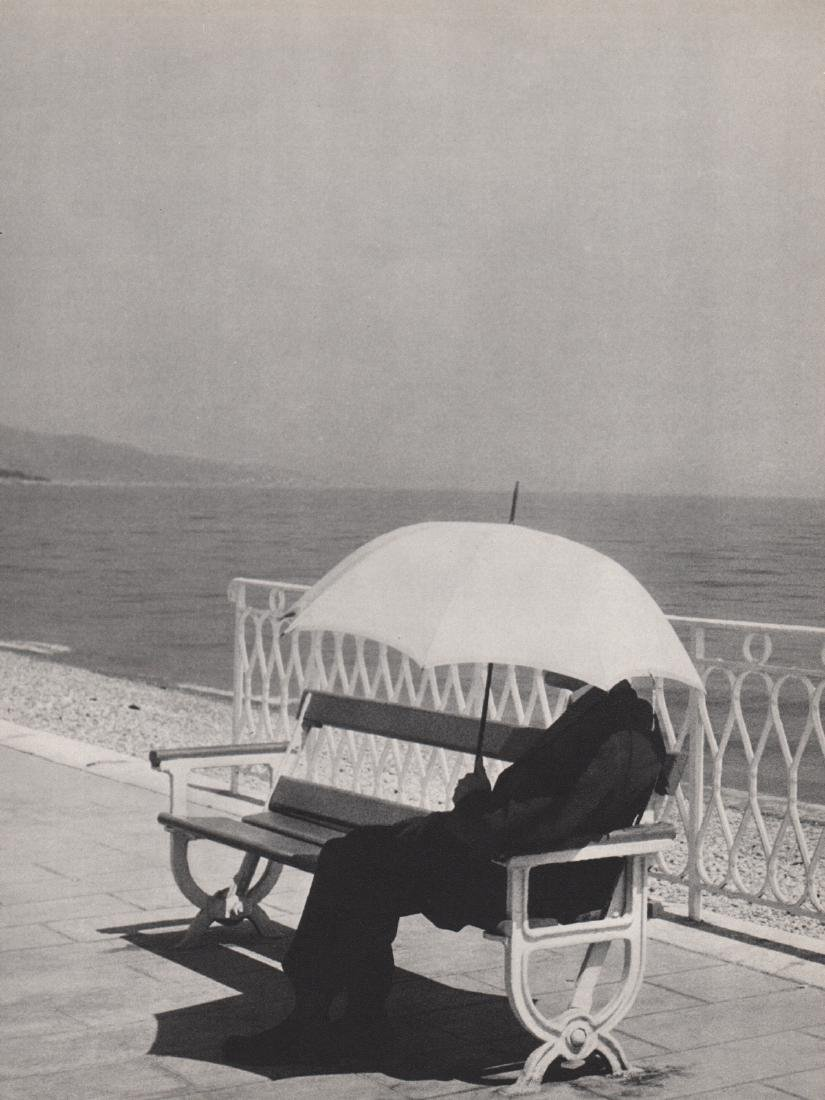 BRASSAI - Man with Umbrella, Menton 1930