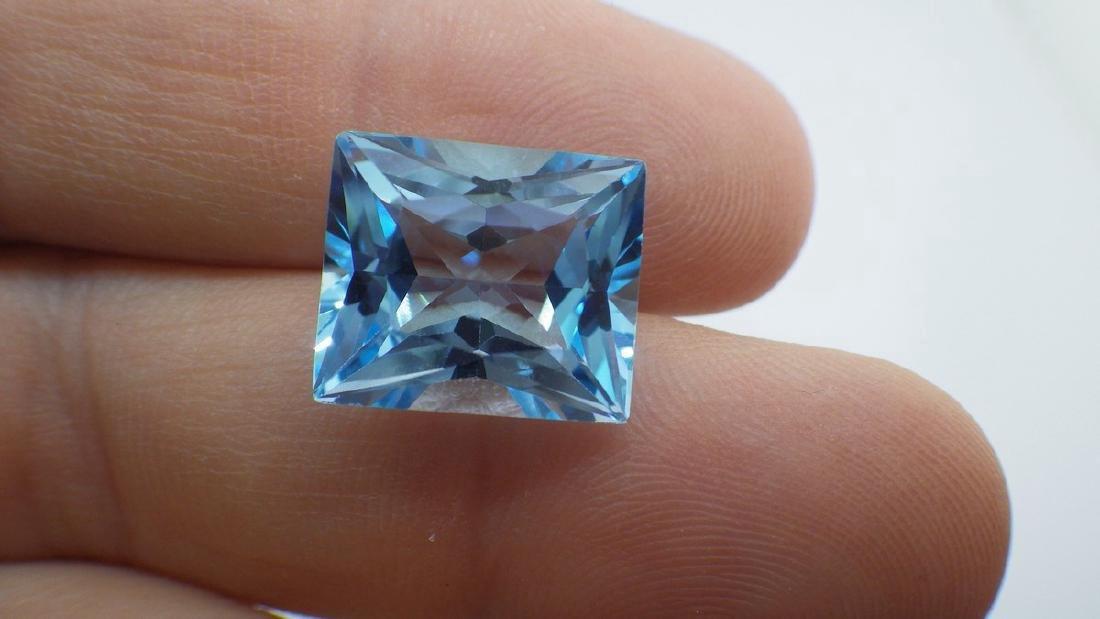 19.61 Carat Loose Emerald Blue Topaz