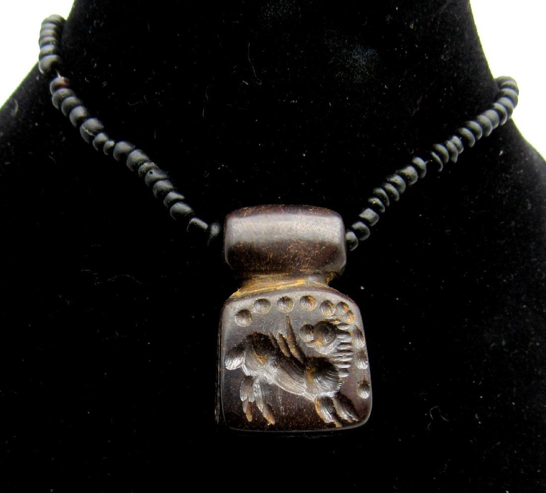 Middle Eastern Tribal Hematite pendant depicting