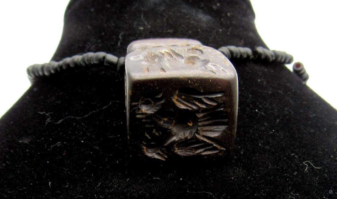 Middle Eastern Tribal Hematite pendant depicting - 2