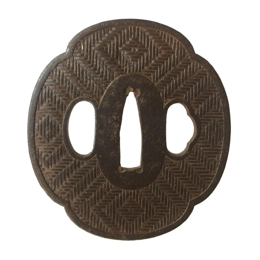 Iron tsuba with woven basket pattern