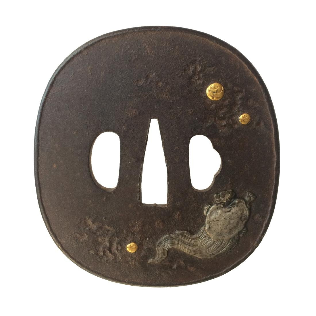 Iron tsuba with gold and silver inlay
