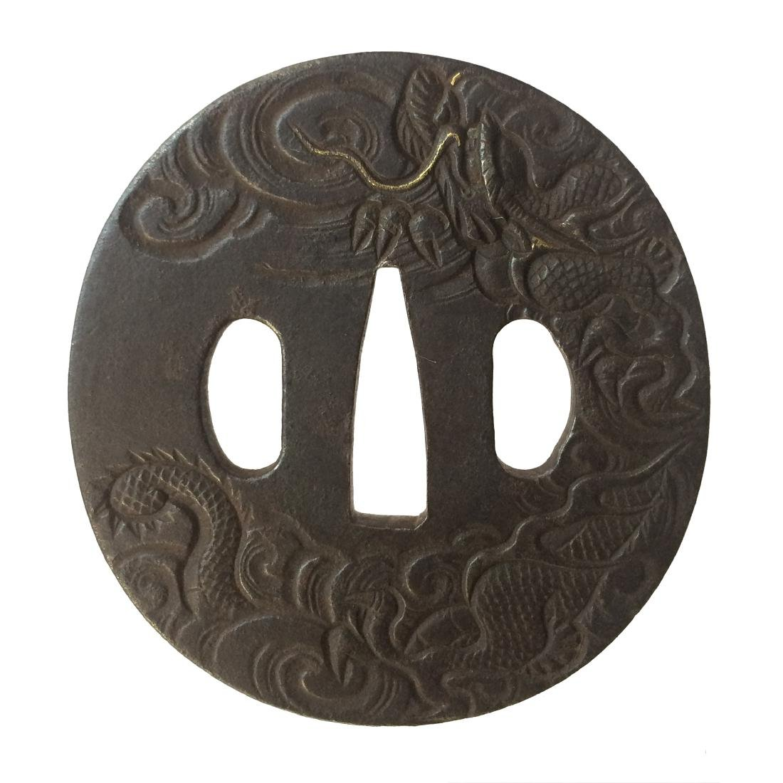 Iron tsuba with a dragon among clouds