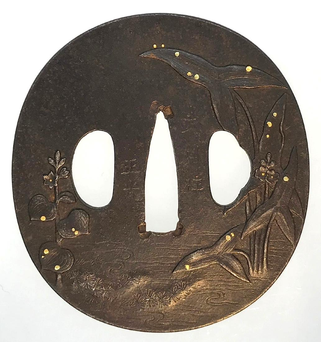 Signed iron tsuba of Bushu-Ito school carved and inlaid