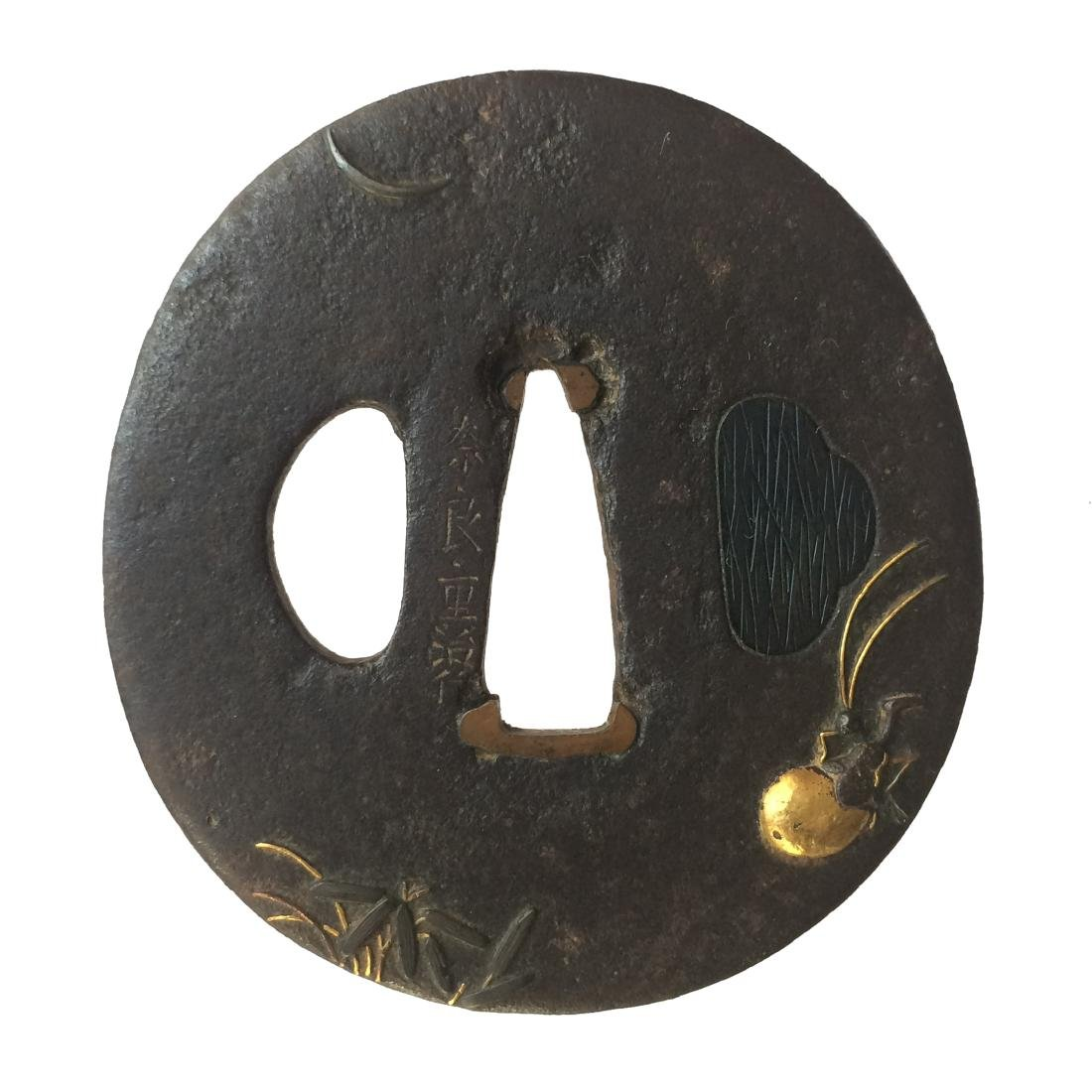 Iron tsuba by Nara Shigeharu with Shakudo and gold