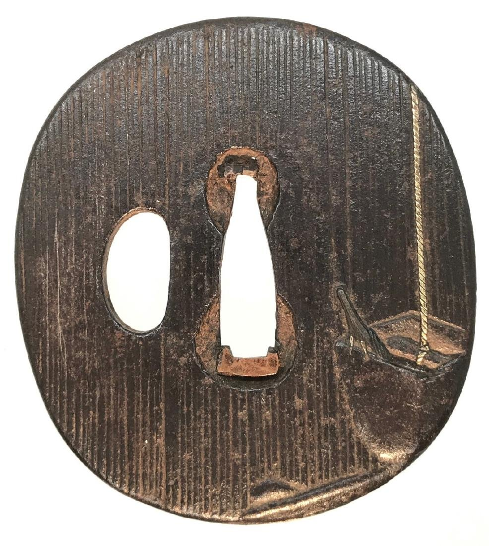 Iron tsuba with gold inlay