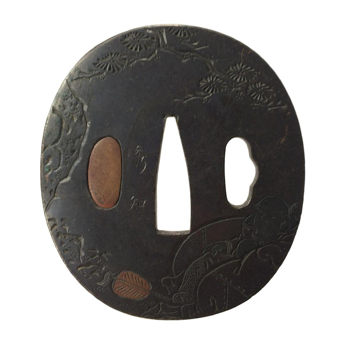 Signed kinko tsuba with katakiribori carving and brass