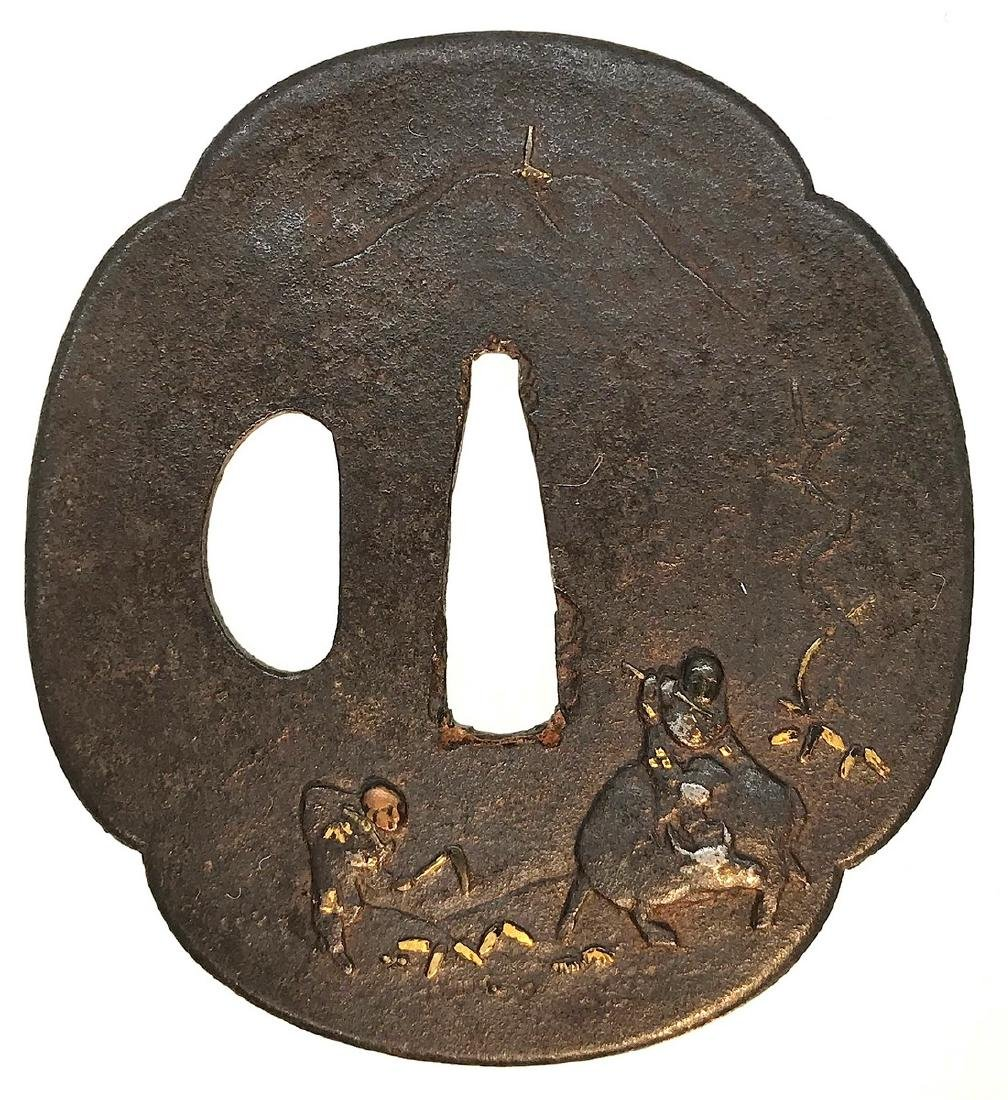 Iron tsuba carved and inlaid with copper, Shakudo