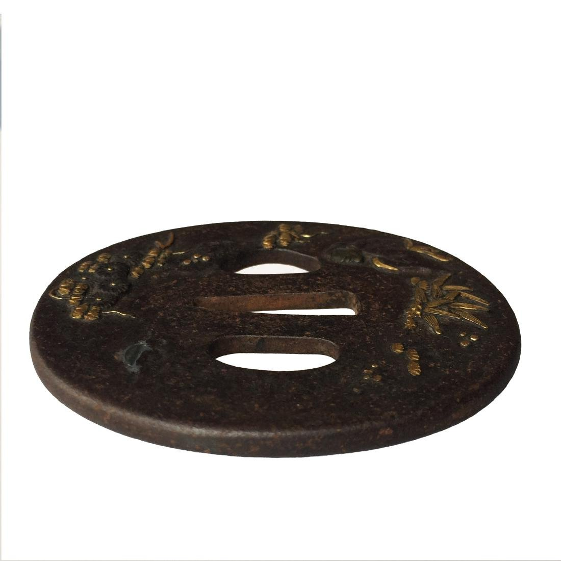 Iron tsuba carved and inlaid with shibuichi and gold - 2