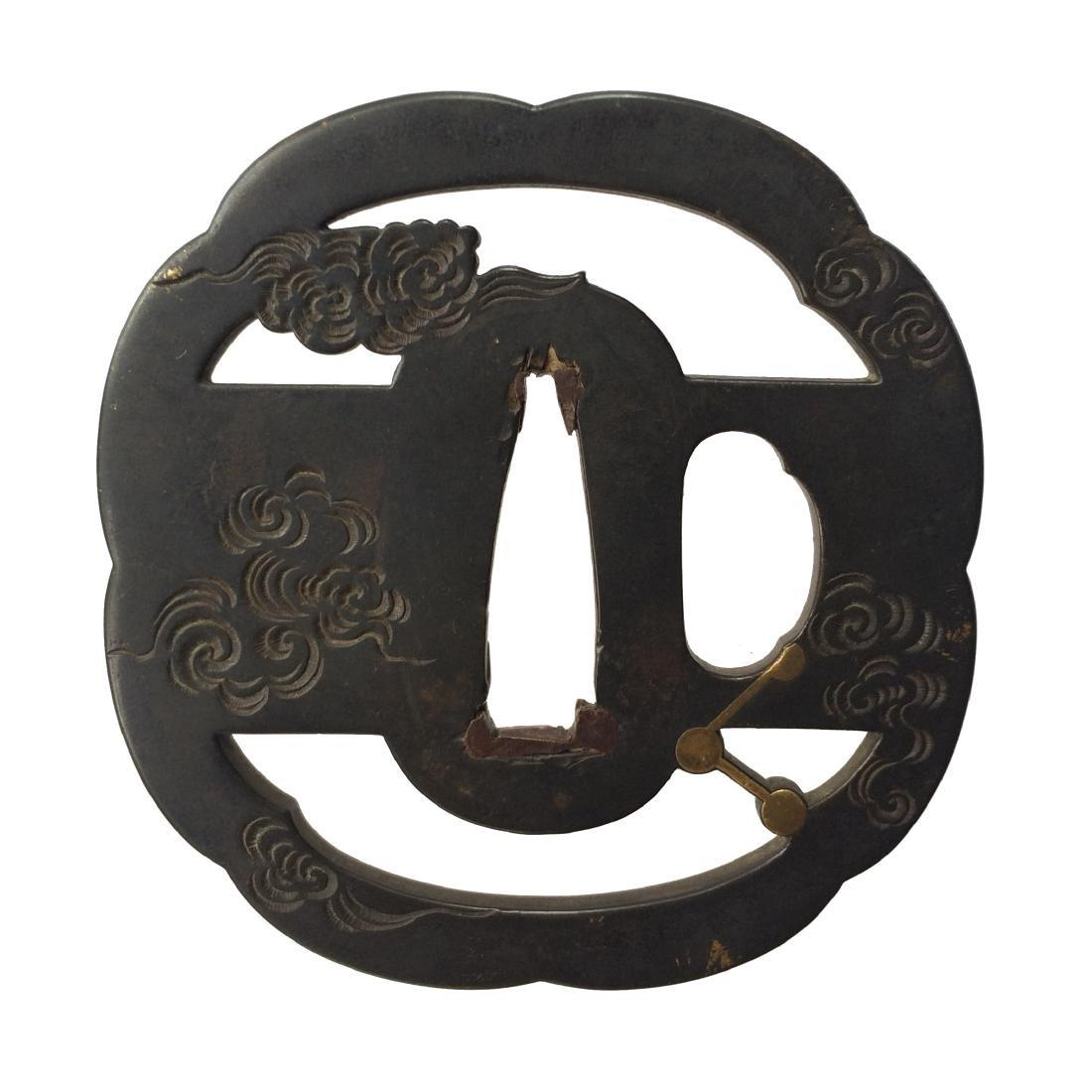 Signed kinko tsuba with celestial motif by Umetada