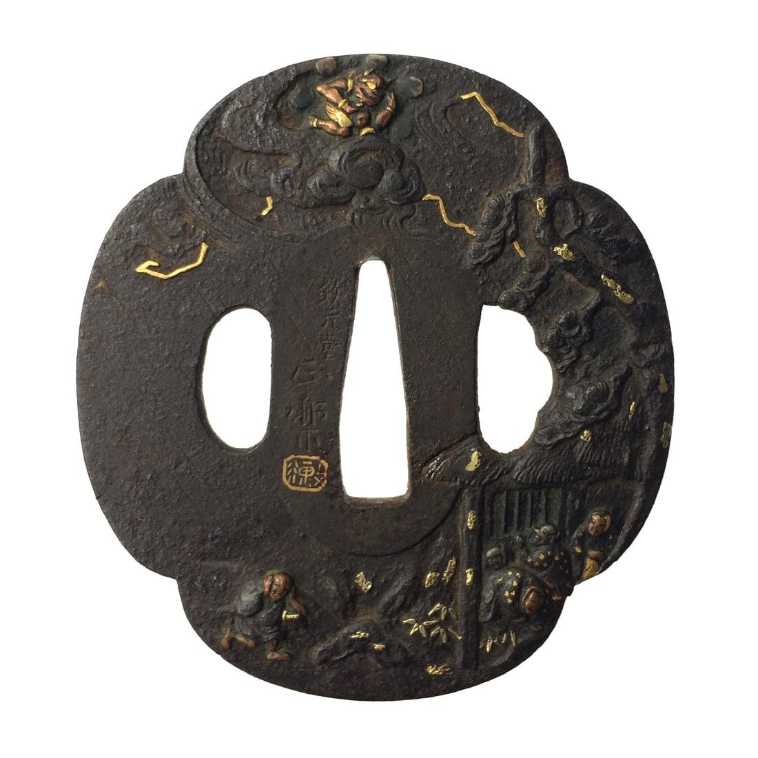 Signed iron tsuba carved and inlaid with gold, copper,